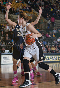 Army Forward Olivia Schretzman (12) handles the ball as the Black Knight's defeated the Navy Midshipmen 54-48 at the United States Military Academy's Christl Arena in West Point, NY on Saturday, February 8, 2014. Hudson Valley Press/CHUCK STEWART, JR.