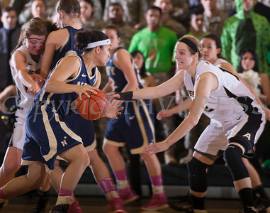Army Forward Olivia Schretzman (12) defends Navy's Alix Membreno (0) as the Black Knight's defeated the Navy Midshipmen 54-48 at the United States Military Academy's Christl Arena in West Point, NY on Saturday, February 8, 2014. Hudson Valley Press/CHUCK STEWART, JR.