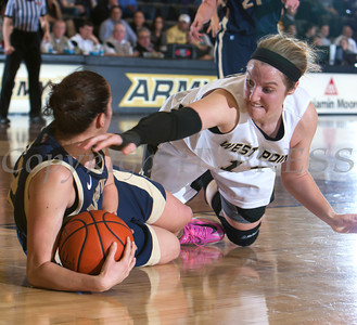 Army Guard Jen Hazlett (1) fights for a loose ball as the Black Knight's defeated the Navy Midshipmen 54-48 at the United States Military Academy's Christl Arena in West Point, NY on Saturday, February 8, 2014. Hudson Valley Press/CHUCK STEWART, JR.