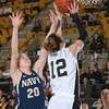 Army Forward Olivia Schretzman (12) drives to the basket past Navy's Audrey Bauer (20). The Black Knight's defeated the Navy Midshipmen 54-48 at the United States Military Academy's Christl Arena in West Point, NY on Saturday, February 8, 2014. Hudson Valley Press/CHUCK STEWART, JR.