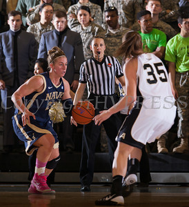 Army Forward Danielle Failor (35) defends Navy's Jade Geif (21) as the Black Knight's defeated the Navy Midshipmen 54-48 at the United States Military Academy's Christl Arena in West Point, NY on Saturday, February 8, 2014. Hudson Valley Press/CHUCK STEWART, JR.