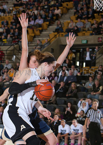 Army Forward Olivia Schretzman (12) drives to the basket as the Black Knight's defeated the Navy Midshipmen 54-48 at the United States Military Academy's Christl Arena in West Point, NY on Saturday, February 8, 2014. Hudson Valley Press/CHUCK STEWART, JR.