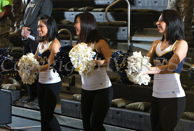 Navy cheerleaders entertain the crowd at the United States Military Academy's Christl Arena in West Point, NY on Saturday, February 8, 2014. Army defeated Navy 54-48. Hudson Valley Press/CHUCK STEWART, JR.