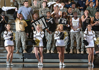 Army cheerleaders entertain the crowd at the United States Military Academy's Christl Arena in West Point, NY on Saturday, February 8, 2014. Army defeated Navy 54-48. Hudson Valley Press/CHUCK STEWART, JR.