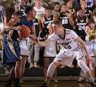 Navy Forward Worth Smith (21) handles the ball as Army's Tanner Plomb (32) defends. The Army Black Knight's were defeated by the Navy Midshipmen 79-57 at the United States Military Academy's Christl Arena in West Point, NY on Saturday, February 8, 2014. Hudson Valley Press/CHUCK STEWART, JR.