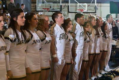 Army cheerleaders sing their alma matter following their defeat by the Navy Midshipment 79-57 at the United States Military Academy's Christl Arena in West Point, NY on Saturday, February 8, 2014. Hudson Valley Press/CHUCK STEWART, JR.