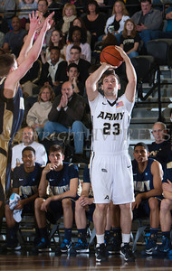 Army Guard Josh Herbeck (23) puts up a 3-pointer as the Black Knight's were defeated by the Navy Midshipmen 79-57 at the United States Military Academy's Christl Arena in West Point, NY on Saturday, February 8, 2014. Hudson Valley Press/CHUCK STEWART, JR.