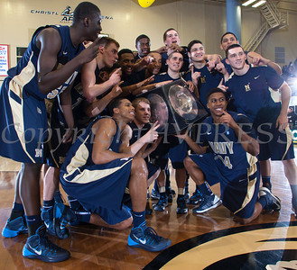 Navy players pose with the Alumni Trophy after defeating the Army Black Knight's 79-57 at the United States Military Academy's Christl Arena in West Point, NY on Saturday, February 8, 2014. Hudson Valley Press/CHUCK STEWART, JR.