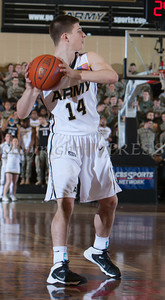 Army Guard Matt Gramling (14) handles the ball as the Black Knight's were defeated by the Navy Midshipmen 79-57 at the United States Military Academy's Christl Arena in West Point, NY on Saturday, February 8, 2014. Hudson Valley Press/CHUCK STEWART, JR.