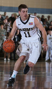 Army Guard Dylan Cox (11) handles the ball as the Black Knight's were defeated by the Navy Midshipmen 79-57 at the United States Military Academy's Christl Arena in West Point, NY on Saturday, February 8, 2014. Hudson Valley Press/CHUCK STEWART, JR.