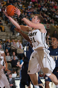Army Forward Kyle Wilson drives to the basket as the Black Knight's were defeated by the Navy Midshipmen 79-57 at the United States Military Academy's Christl Arena in West Point, NY on Saturday, February 8, 2014. Hudson Valley Press/CHUCK STEWART, JR.