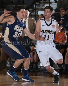 Army Guard Dylan Cox (11) drives to the basket as Brandon Venturini (33) defends. The Black Knight's were defeated by the Navy Midshipmen 79-57 at the United States Military Academy's Christl Arena in West Point, NY on Saturday, February 8, 2014. Hudson Valley Press/CHUCK STEWART, JR.