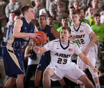 Army's Josh Herbeck (23) defends Navy's Kendall Knorr (1). The Black Knight's were defeated by the Navy Midshipmen 79-57 at the United States Military Academy's Christl Arena in West Point, NY on Saturday, February 8, 2014. Hudson Valley Press/CHUCK STEWART, JR.