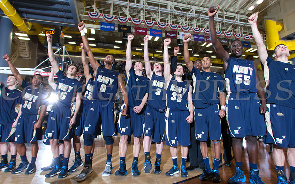 The Navy Midshipmen celebrate their 79-57 victory over the Army Black Knight's at the United States Military Academy's Christl Arena in West Point, NY on Saturday, February 8, 2014. Hudson Valley Press/CHUCK STEWART, JR.