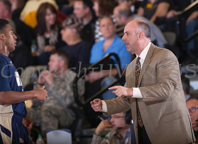 Navy head coach Ed DeChellis talks with a player as the Army Black Knight's were defeated by the Navy Midshipmen 79-57 at the United States Military Academy's Christl Arena in West Point, NY on Saturday, February 8, 2014. Hudson Valley Press/CHUCK STEWART, JR.