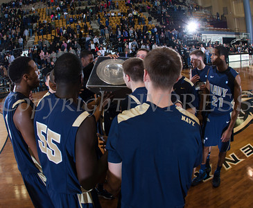 Navy players receive the Alumni Trophy after defeating the Army Black Knight's 79-57 at the United States Military Academy's Christl Arena in West Point, NY on Saturday, February 8, 2014. Hudson Valley Press/CHUCK STEWART, JR.