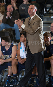 Navy head coach Ed DeChellis cheers on his players as the Black Knight's were defeated by the Navy Midshipmen 79-57 at the United States Military Academy's Christl Arena in West Point, NY on Saturday, February 8, 2014. Hudson Valley Press/CHUCK STEWART, JR.