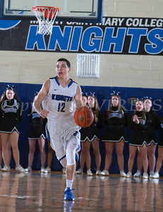Mount Saint Mary G Stephen Steyer (12) handles the ball as the Knight's defeated the Yeshiva University Maccabees 88-58 in their Skyline Conference game on Thursday, January 23, 2014 in the Kaplan Center in Newburgh, NY. Hudson Valley Press/CHUCK STEWART, JR.