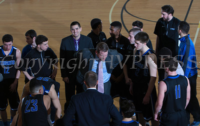The Mount Saint Mary Knight's huddle up for instructions from head coach Ryan Kadlubowski as they defeated the Farmingdale State Rams 69-58 in their Skyline Conference game on Saturday, February 22, 2014 in the Kaplan Center in Newburgh, NY. Hudson Valley Press/CHUCK STEWART, JR.