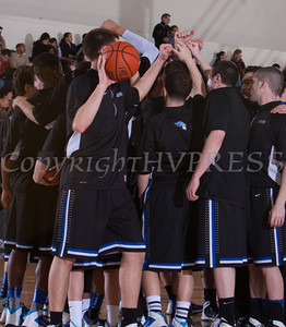 The Mount Saint Mary Knight's huddle up prior to defeating the Farmingdale State Rams 69-58 in their Skyline Conference game on Saturday, February 22, 2014 in the Kaplan Center in Newburgh, NY. Hudson Valley Press/CHUCK STEWART, JR.