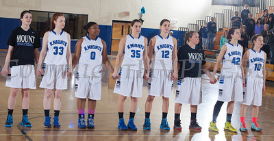 The Mount Saint Mary College women's basketball team hold hands during the national anthem prior taking on the Old Westbury Panthers, in their Skyline Conference game Sunday, February 23, 2014 at the Kaplan Center in Newburgh, NY. The Panthers defeated the Mount 76-69. Hudson Valley Press/CHUCK STEWART, JR.