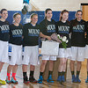 The Mount Saint Mary College women's basketball team poses for a picture on senior day with assistant coach Christina Jordan (far left) and head coach Michael Coppolino (far right) on Sunday, February 23, 2014 at the Kaplan Center in Newburgh, NY. Hudson Valley Press/CHUCK STEWART, JR.