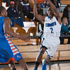 Knight Guard Donte Howell (2) drives to the basket against the Panther as the Mount Saint Mary Knight's were defeated by the SUNY Purchase Panthers 81-66 in their Skyline Conference game on Thursday, January 9, 2014 in the Kaplan Center in Newburgh, NY. Hudson Valley Press/CHUCK STEWART, JR.