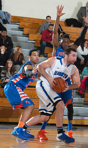 knight Forward Chris Pisciotta (10) handles the ball the Mount Saint Mary Knight's were defeated by the SUNY Purchase Panthers 81-66 in their Skyline Conference game on Thursday, January 9, 2014 in the Kaplan Center in Newburgh, NY. Hudson Valley Press/CHUCK STEWART, JR.