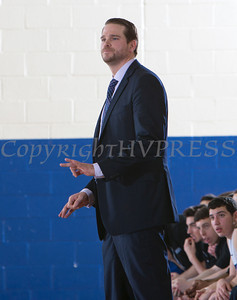 Mount Saint Mary Knight's head coach Ryan Kadlubowski gives directions to players who were defeated by the SUNY Purchase Panthers 81-66 in their Skyline Conference game on Thursday, January 9, 2014 in the Kaplan Center in Newburgh, NY. Hudson Valley Press/CHUCK STEWART, JR.