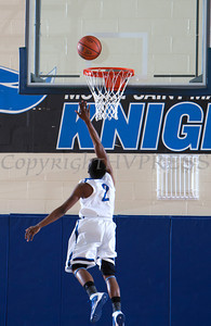 Knight Guard Donte Howell (2) drives to the basket as the Mount Saint Mary Knight's were defeated by the SUNY Purchase Panthers 81-66 in their Skyline Conference game on Thursday, January 9, 2014 in the Kaplan Center in Newburgh, NY. Hudson Valley Press/CHUCK STEWART, JR.