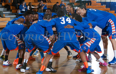 The Purchase Panthers huddle up prior to their game. The Mount Saint Mary Knight's were defeated by the SUNY Purchase Panthers 81-66 in their Skyline Conference game on Thursday, January 9, 2014 in the Kaplan Center in Newburgh, NY. Hudson Valley Press/CHUCK STEWART, JR.