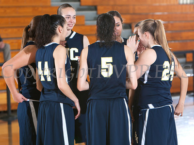 St. Joseph's Golden Eagles huddle up prior to the Mount Saint Mary College women's basketball team defeated them, 70-54, winning their first Skyline Conference game of the season on Saturday, January 18, 2014 at the Kaplan Center in Newburgh, NY. Hudson Valley Press/CHUCK STEWART, JR.