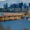 MBTA 1017 takes a Haverhill train over the Mystic River on the Dana Bridge.