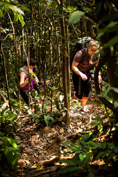 Tracy and Aurora follow up a steep jungle trail.