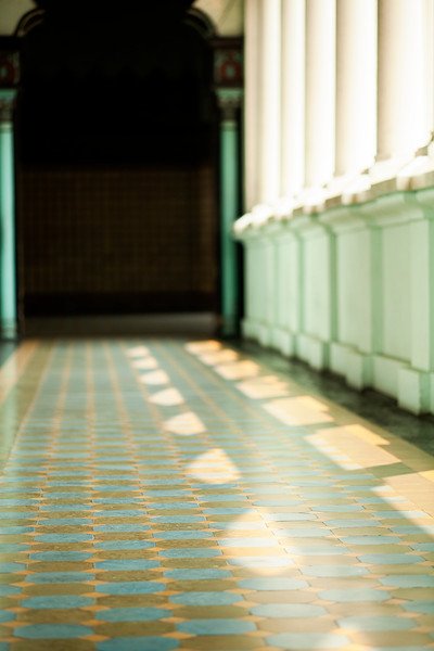 Shadows play across the floor around the edges of the mosque.