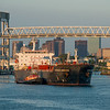 The Tanker Overseas Ambermar passes under the Chelsea Street Bridge at sunrise with the tug Freedom.