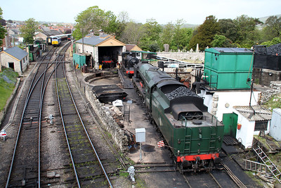 4-6-2 34028 'Eddystone' and 0-4-4T 30053 sit on Swanage shed.
