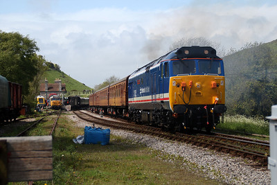 50026 'Indomitable' departs Corfe Castle for Swanage.