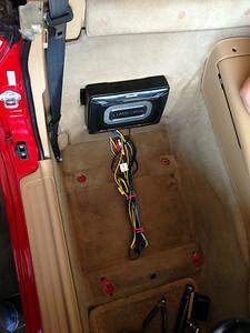 Subwoofer mounted behind passenger seat