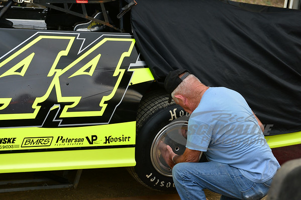 Chris Madden crew member tightens a wheel cover