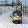 Amtrak train 165 kicks up the snow at comming into Readville in Boston.