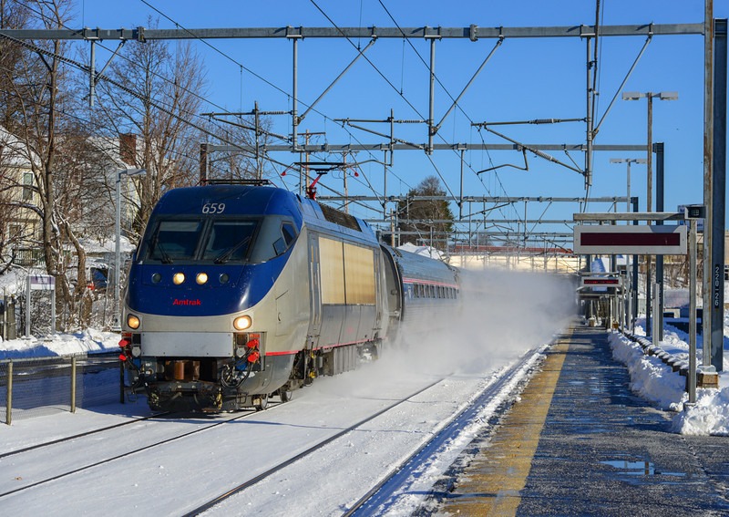Amtrak 99 passes through Hyde Park Station on the Northeast Corridor 19 minutes after leaving South Station.
