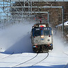 Amtrak Train 161 kicking up the fresh snow from Nor'easter the day on the curve before Hyde Park Station in Boston, February 16, 2014.