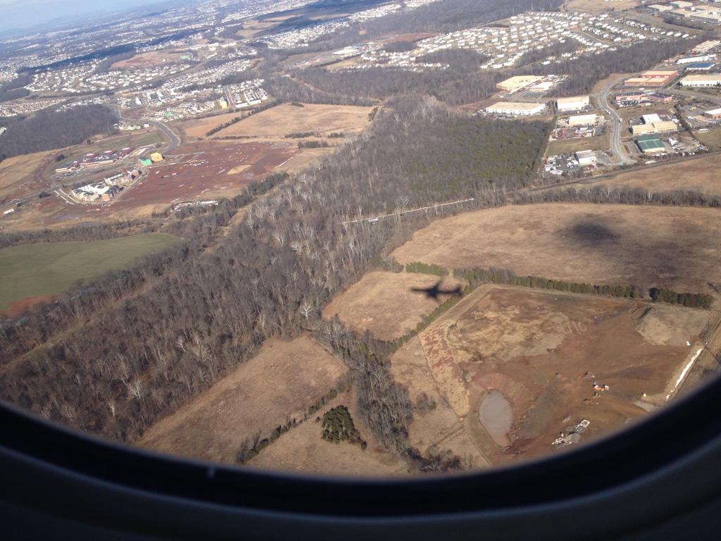 Our plane's shadow leaving Washington Dulles.