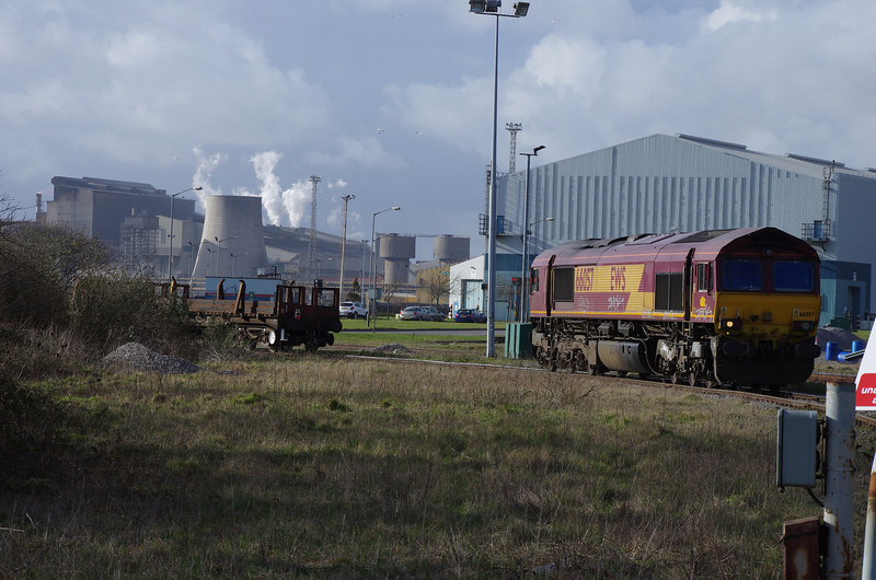 66057 follows an empty stab carrying train into the steelworks complex at Margam 22/03/14