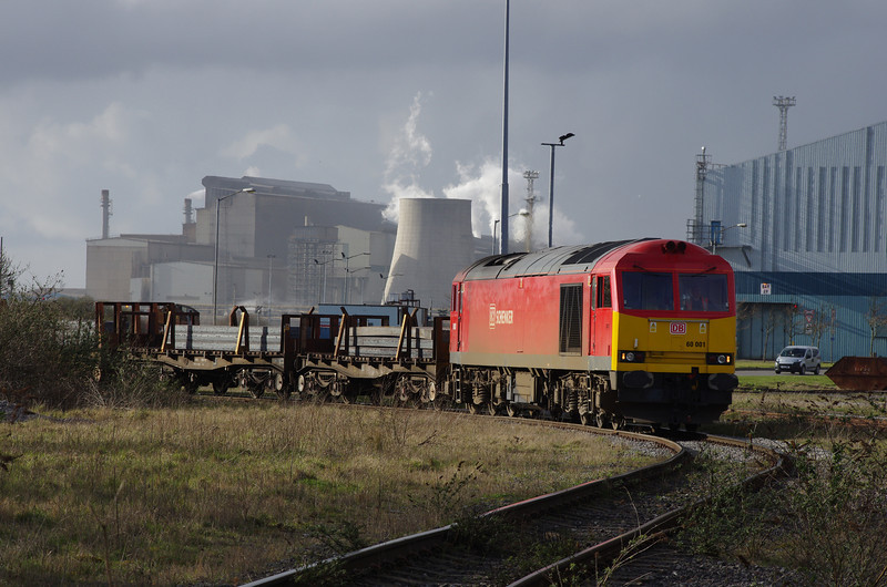 60001 brings a loaded steel slab train out of the Margam steelworks complex 22/03/14