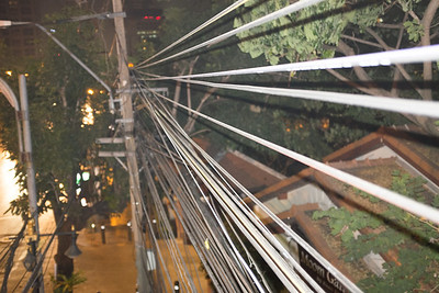 Wires next to the stairs on the pedestrian bridge.