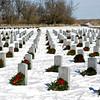 Lathan Goumas - lgoumas@shawmedia.com<br /> Wreaths decorate headstones at the Abraham Lincoln National Cemetery on Wednesday, Dec. 18, 2013.