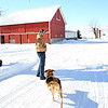 Rob Winner – rwinner@shawmedia.com<br /> <br /> Dave Kestel and his dog, Lucky, are seen on his family's property in Manhattan, Ill., Friday, Feb. 7, 2014. Kestel, a fourth-generation farmer, grows soybean and corn.