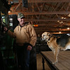 Rob Winner – rwinner@shawmedia.com<br /> <br /> Dave Kestel and his dog, Lucky, are seen inside one of his buildings that store his farm equipment during the winter months on his family's property in Manhattan, Ill., Friday, Feb. 7, 2014. Kestel is a fourth-generation farmer.
